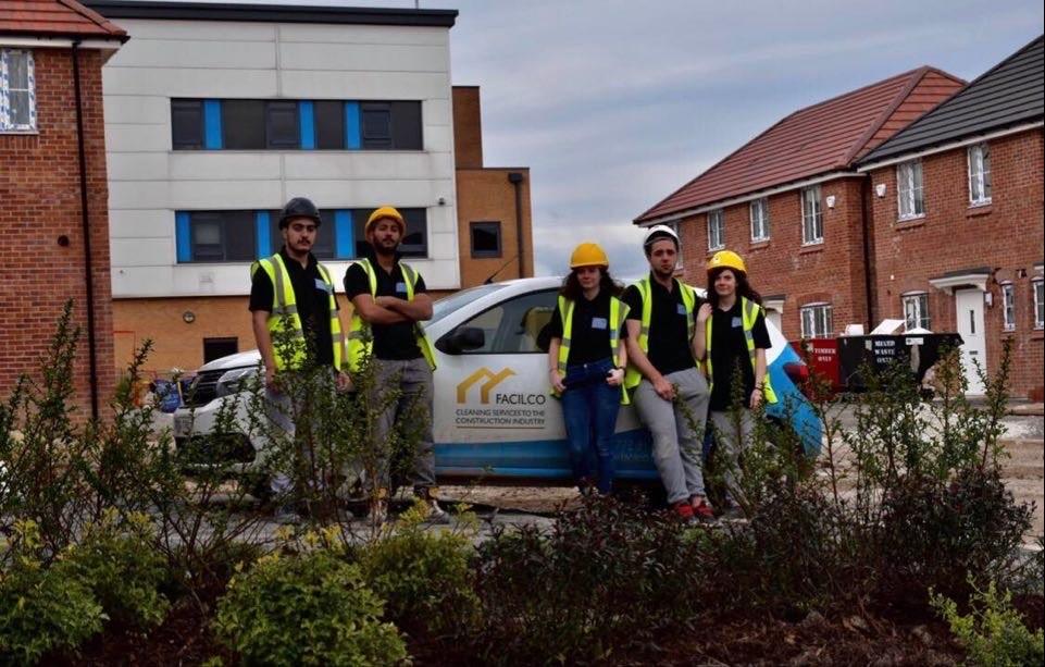 Facilco team in front of a Facilco vehicle