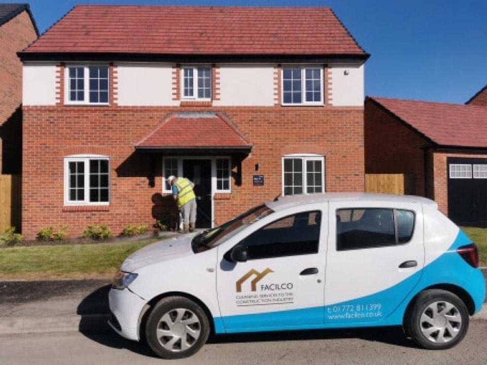 Facilco car in front of a newly built house