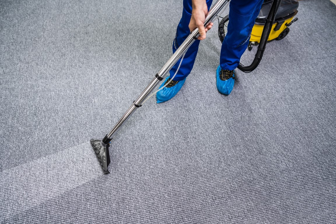 Commercial cleaner cleaning a carpet