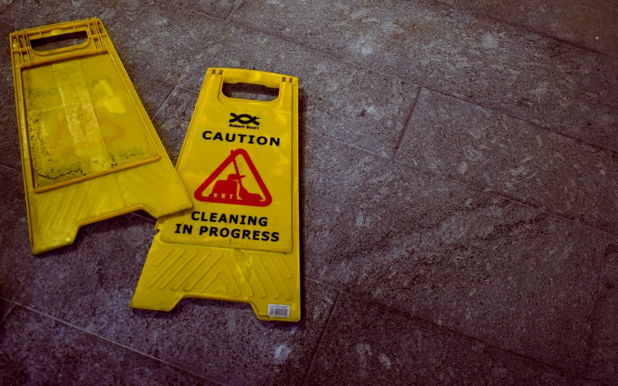 Caution - cleaning in progress signs on the floor