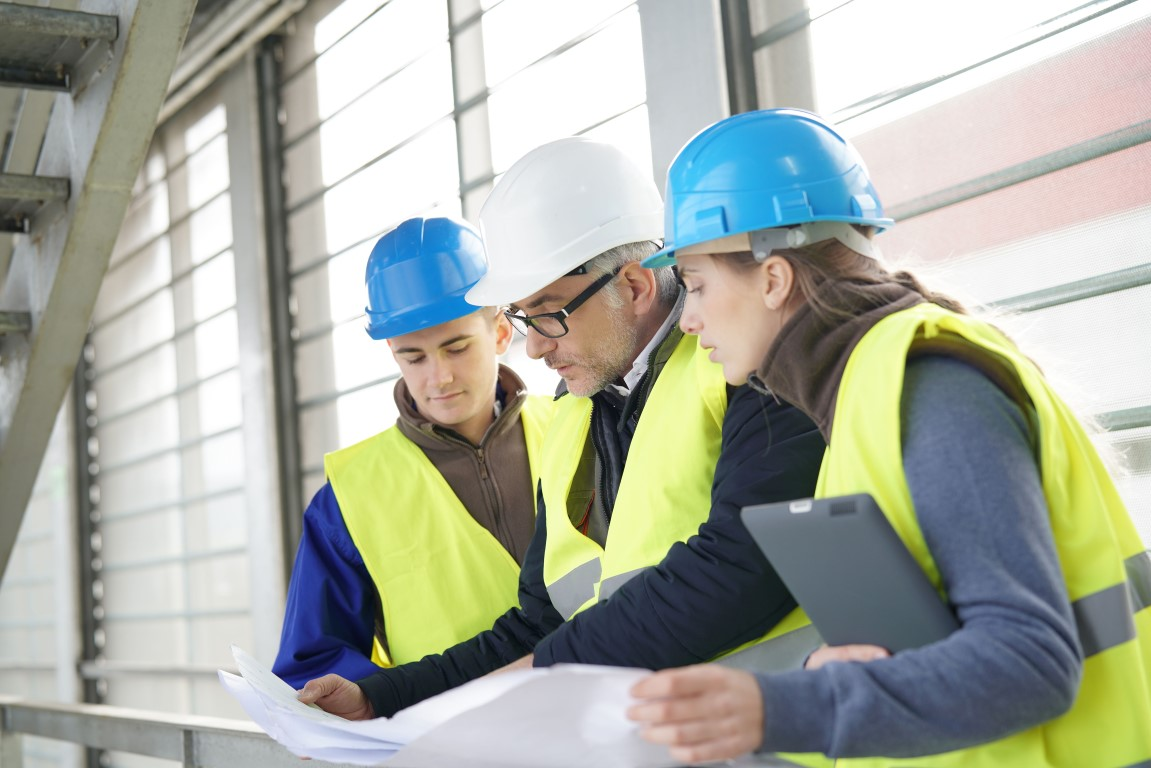Construction manager discusses health and safety with his team